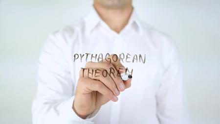 Pythagorean Theorem, Man Writing on Glass Stock Photo