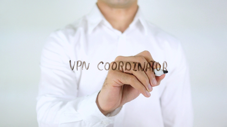VPN Coordinator, Man Writing on Glass Stock Photo