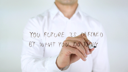 Your Future Is Defined By What You Do today, Man Writing on Glass Stock Photo