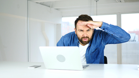 Searching Gesture by Man in Office, Finding a Path Stock Photo