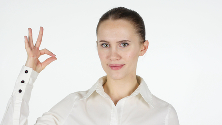 Okay Gesture by Woman, White Background Stock Photo