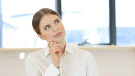 fantasize: Pensive Woman, Brainstorming in Office at Work