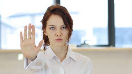 Stop Gesture by Woman in Office at Work Stock Photo