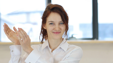 Clapping Woman, Applauding in Ofice at Work Stock Photo