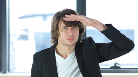 Searching Gesture by Man In His Office at Work