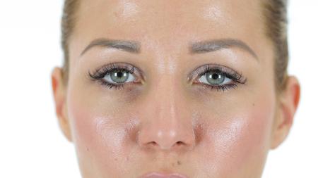 Blinking Eyes of Woman Isolated on White Background