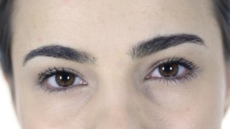 Blinking Eyes of Woman isolated on white background Stok Fotoğraf
