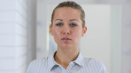 Portrait of Woman in Office at Work