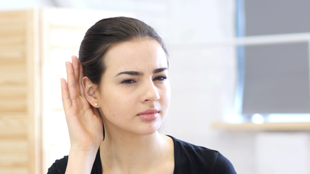 Woman Listening Secret Carefully in Office at Work