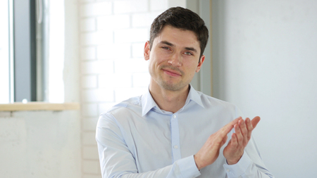 Applauding, Clapping Businessman in Office at Work Stock Photo