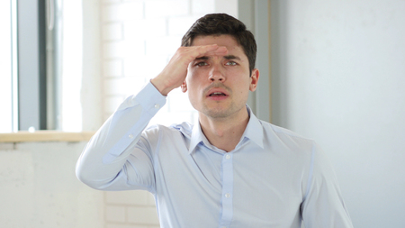 Creative Man Searching Lost Idea, Gesture at Work