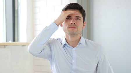 Young Man Searching New Job, New Path at Work Stock Photo