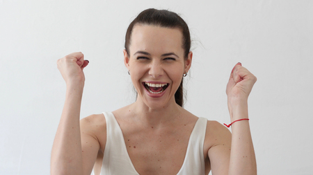 Excited Young Woman Celebrating Success, Portrait in Designer Office Stok Fotoğraf