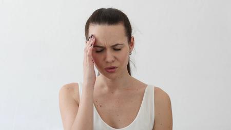 Headache, Tense Beautiful Young Woman, Portrait in Designer Office Stock Photo