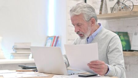 Senior Old Man Working in Office on Contract, Paperwork