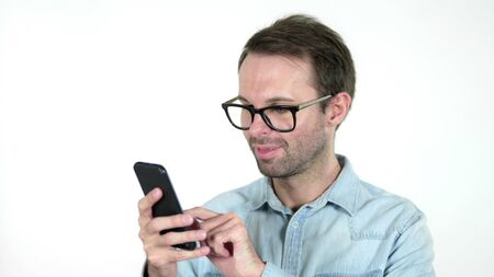Casual Man Browsing Smartphone Isolated on White Background