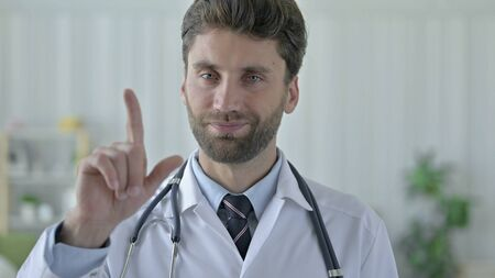 Serious Young Doctor saying No with Finger Sign
