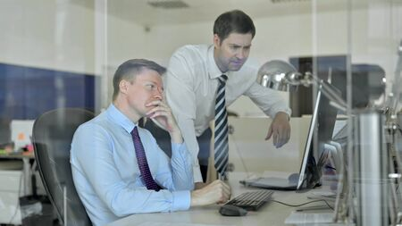 Upset Mature Businessmen getting Shocked while using Office Computer