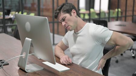 Back Pain, Uncomfortable Young Man Working on Computer