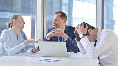 Business people Shocked by Failure on Laptop Stock Photo