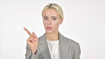 Businesswoman Waving Finger to Refuse on White Background 免版税图像
