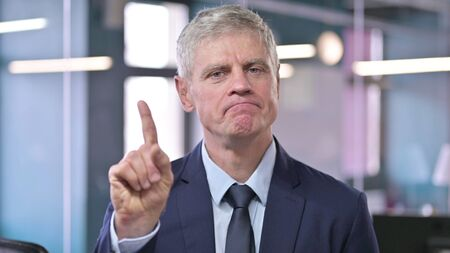 Portrait of Middle Aged Businessman saying No with Finger 免版税图像
