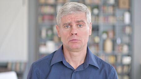 Portrait of Shocked Man getting Upset in Office