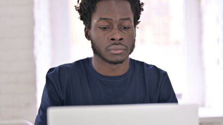 Close Up of Young African Man Working on Laptop