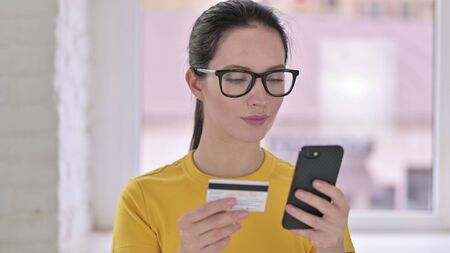 Online Payment on Smartphone by Young Female Designer