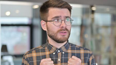 Portrait of Intimidated Young Designer feeling Scared in Office