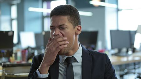 Portrait of African Businessman Yawning in Office