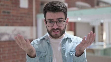 Upset Young Man in Glasses feeling Angry