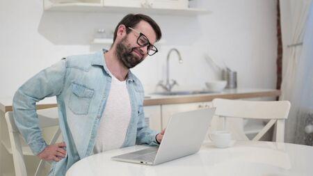 Hardworking Beard Young Man having Back Pain 版權商用圖片