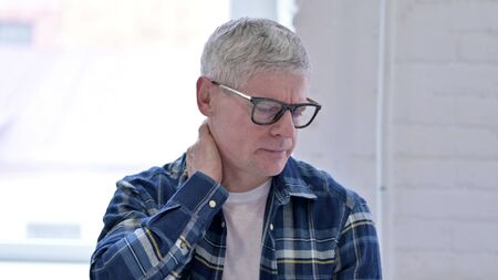Portrait of Tired Casual Middle Aged Man having Neck Pain
