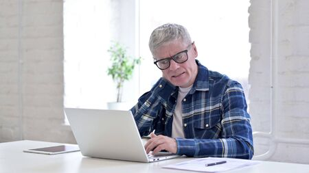 Hardworking Casual Middle Aged Man having Neck Pain