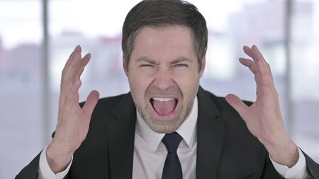 Portrait of Angry Middle Aged Businessman Shouting 版權商用圖片
