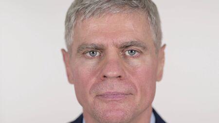 Close Up of Senior Businessman Face Looking at Camera