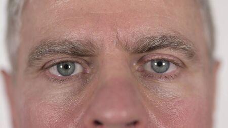 Close up of Blinking Eyes of Senior Man 版權商用圖片