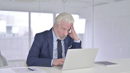 Disappointed Old Businessman feeling Angry in Office