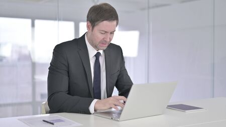 Disappointed Middle Aged Businessman feeling Angry in Office