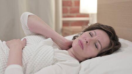 Sleeping Old Woman having Neck Pain in Bed 版權商用圖片