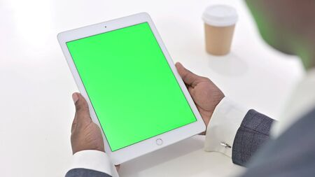 African Man Using Tablet with Green Chroma Key Screen Zdjęcie Seryjne