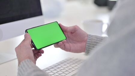 Smartphone with Chroma Key Screen at Work