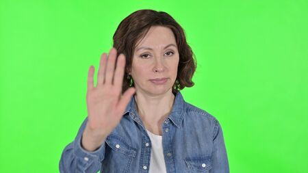 Stop Gesture by Old Woman on Green Chroma Key Background