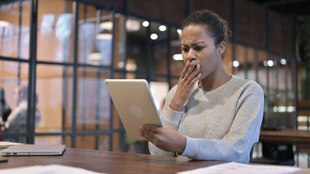 African Woman Upset by Loss on Tablet