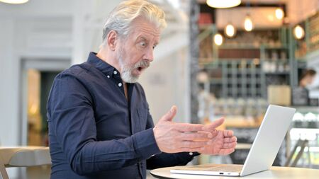 Loss on Laptop by Upset Old Man in Cafe