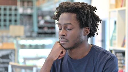 Portrait of Exhausted African Man taking Nap Imagens