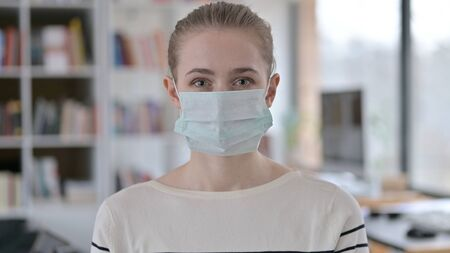 Portrait of Young Woman with Protective Face Mask