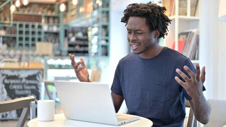 Loss on Laptop by Upset African Man in Cafe