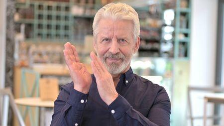 Portrait of Appreciative Old Man Clapping, Cheering